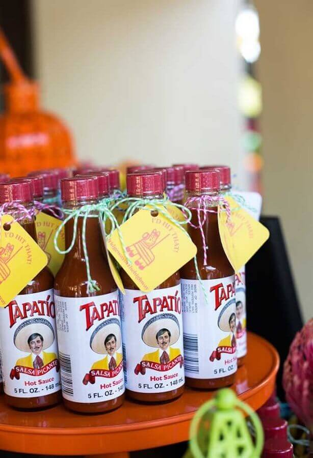 bottles of customized sauces for mexican party Photo My Party