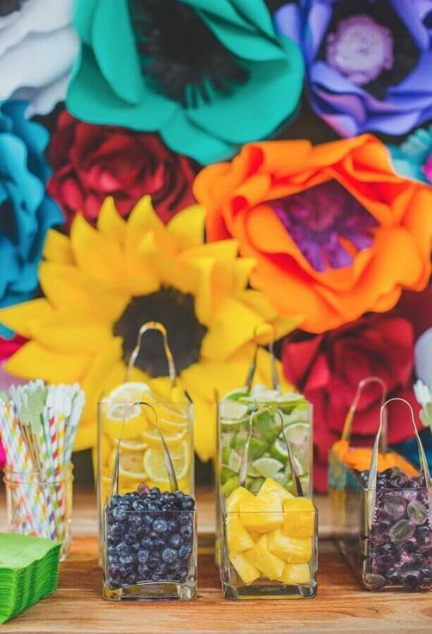 panel of colored paper flowers and jugs with fruit for Mexican party Photo My Sweet Decor