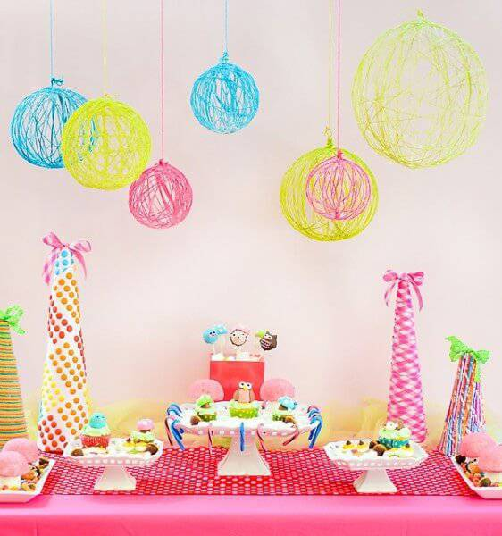 children's party decoration with tall dishes and balls