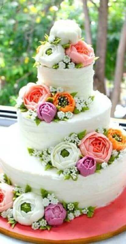wedding cake decorated with flowers for tropical party Foto Pinterest