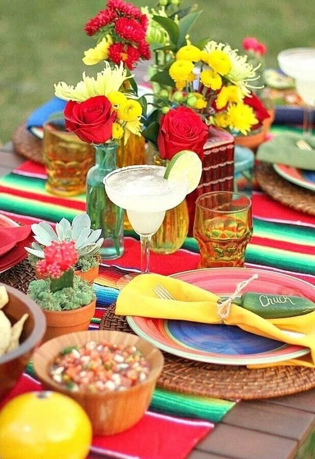 striped towel and colorful flower arrangements for Mexican party Photo My Sweet Decor