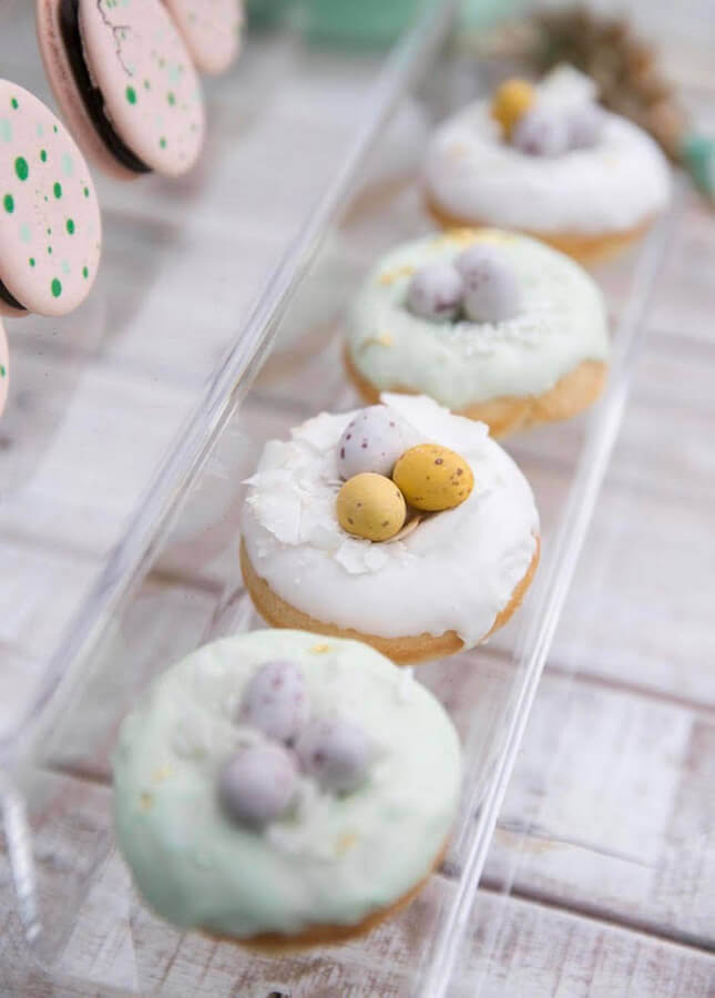doughnuts decorated with dinosaur party eggs Photo Kara's Party Ideas