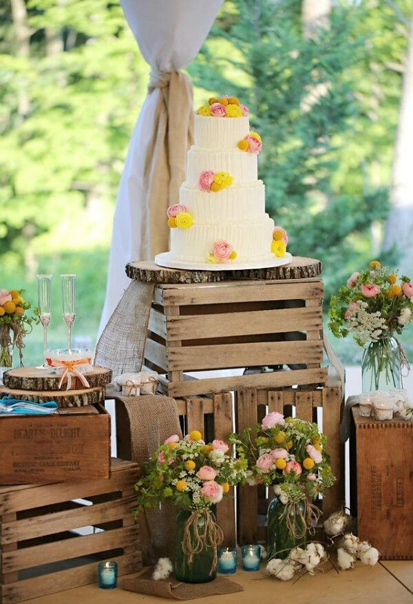 The cake table can be made with wooden boxes
