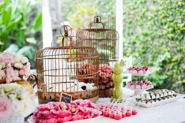 Decorative cages can serve as a base for the party candies