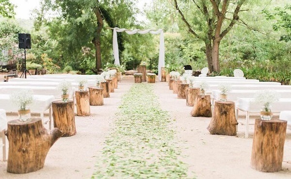 Simple wedding decoration with tree trunks