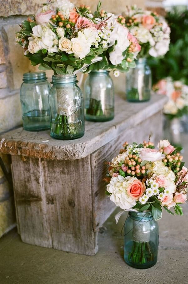 Use glass jars to form beautiful floral arrangements