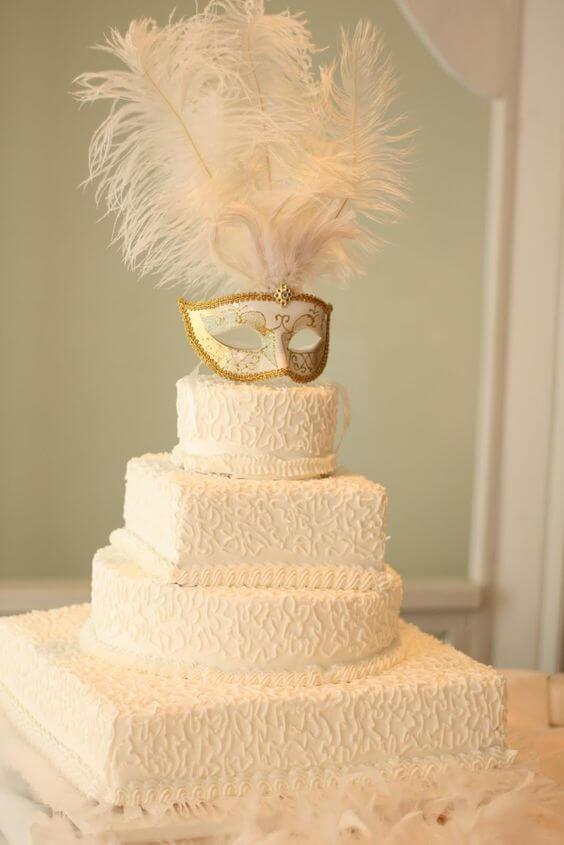 White and gold masquerade cake