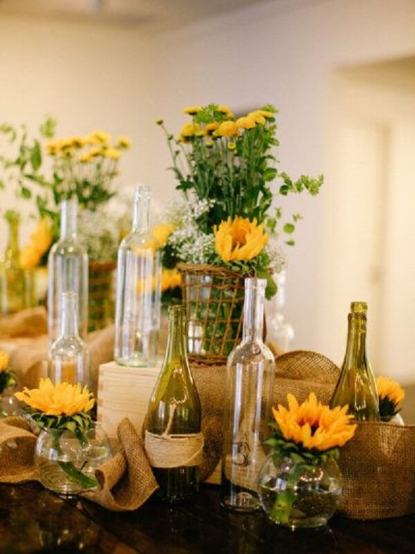 Separate glass bottles to make up the sunflower theme party decoration