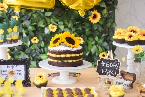 The flowers were spread all over the table of the sunflower theme cake party