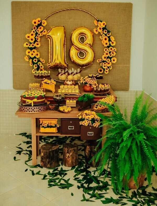 Simple table for sunflower theme party with wooden table and fern flower