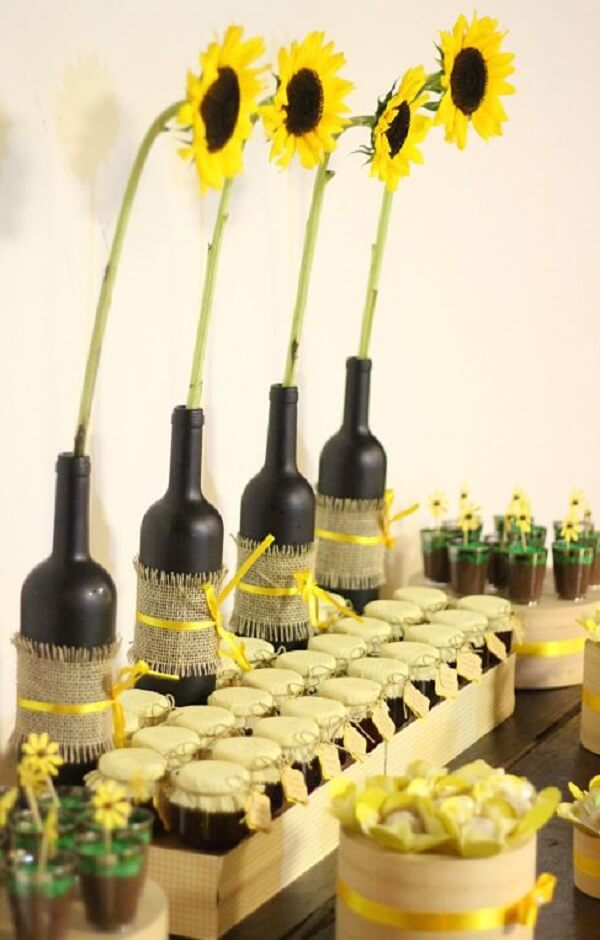 Glass bottles, jute fabric and ribbons for sunflower theme party decoration