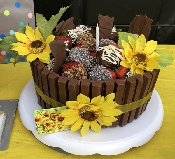 Cake made with Kit Kat and strawberries for sunflower theme party