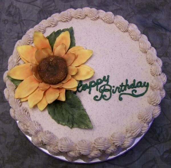 Round cake with simple finish for sunflower theme party