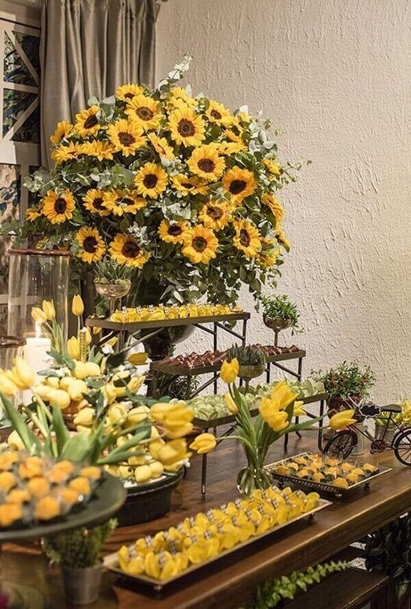 Form a beautiful floral arrangement for the cake table