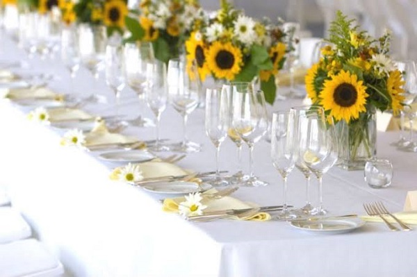 Guests also deserve a sunflower theme party table decorated