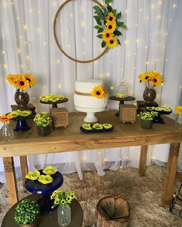 Simple decoration for sunflower theme party with blinker curtain and wooden table