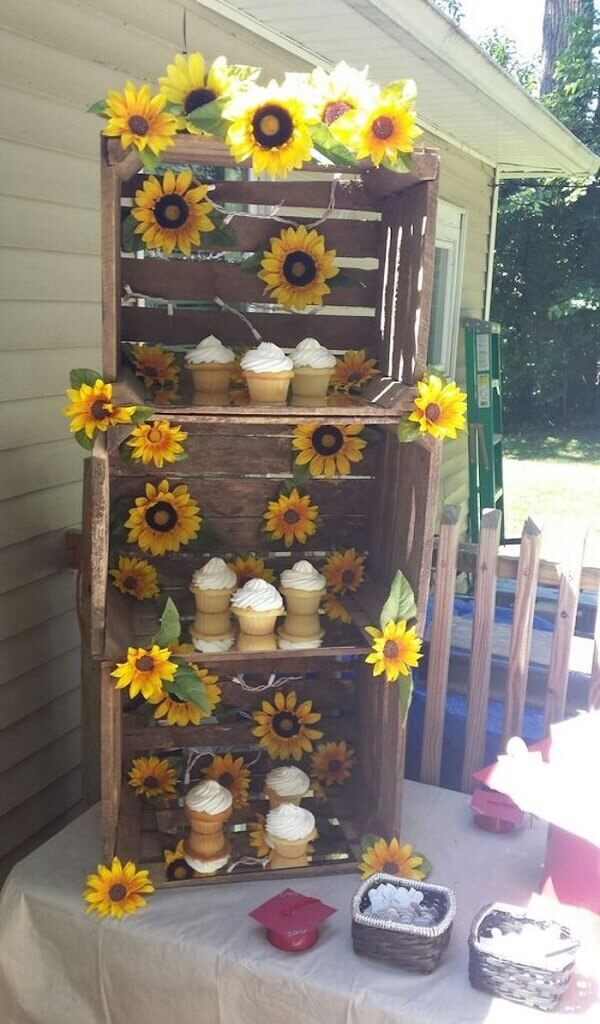 Use wooden boxes in the sunflower theme party decoration