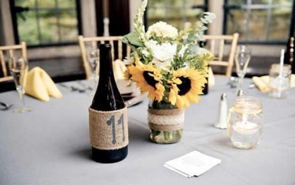 Decorate the guest table with simple arrangements for sunflower theme party