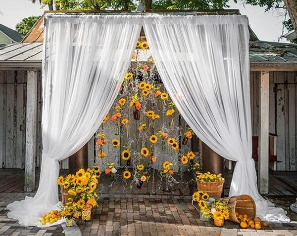 Outdoor decoration with curtain and flowers for sunflower theme party