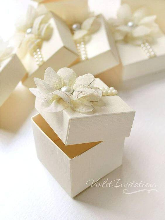 Little souvenir box with fabric flower and pearls