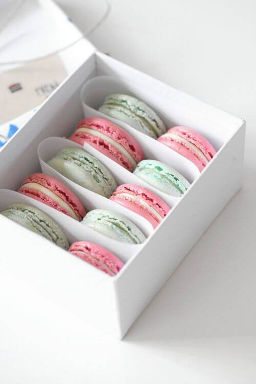 Little souvenir box with colored macaroons inside