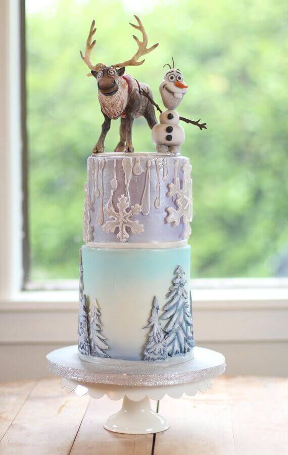 frozen two-story cake with characters on top Photo Celebrating with Affection
