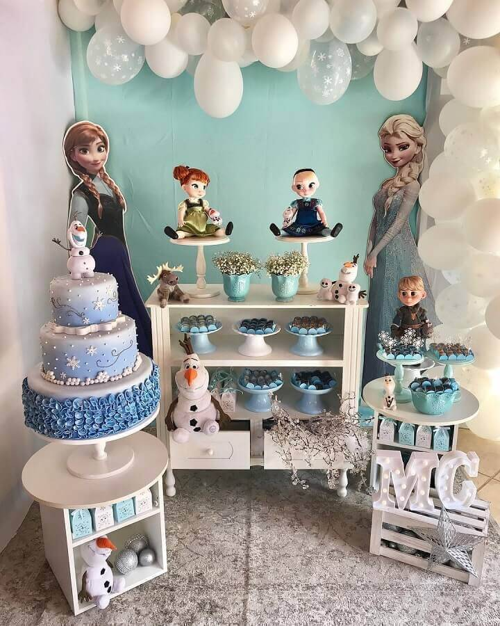 simple party decorated with frozen 3 floor cake with ofaf on top Photo House in Party