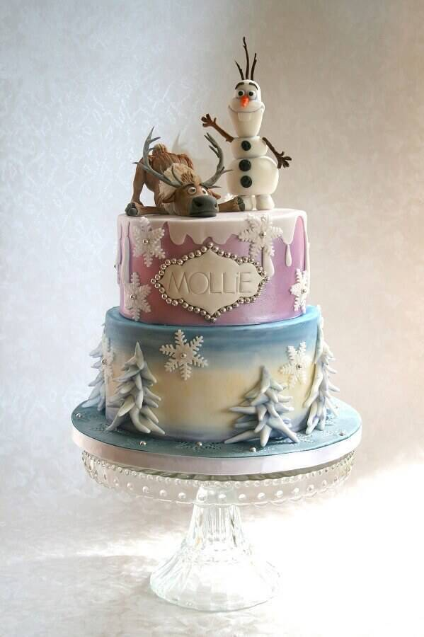 beautiful frozen cake decorated with characters on top and metallic details Photo Celebrating with Affection