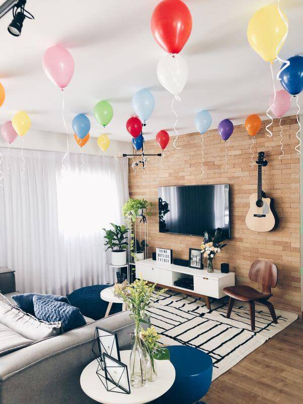 Party at home with balloons on the living room ceiling