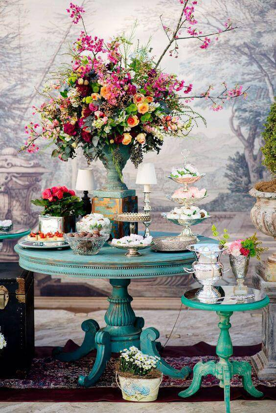 Colorful home party decoration with flower arrangements and antique furniture