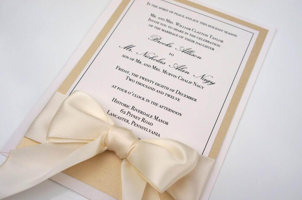 simple wedding invitation with beige satin ribbon