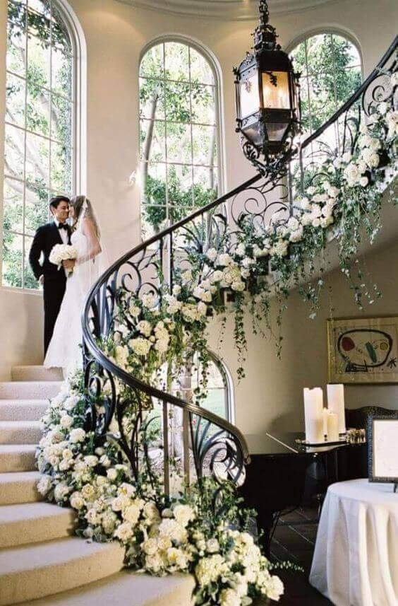 Staircase decorated with natural flowers for a wedding party