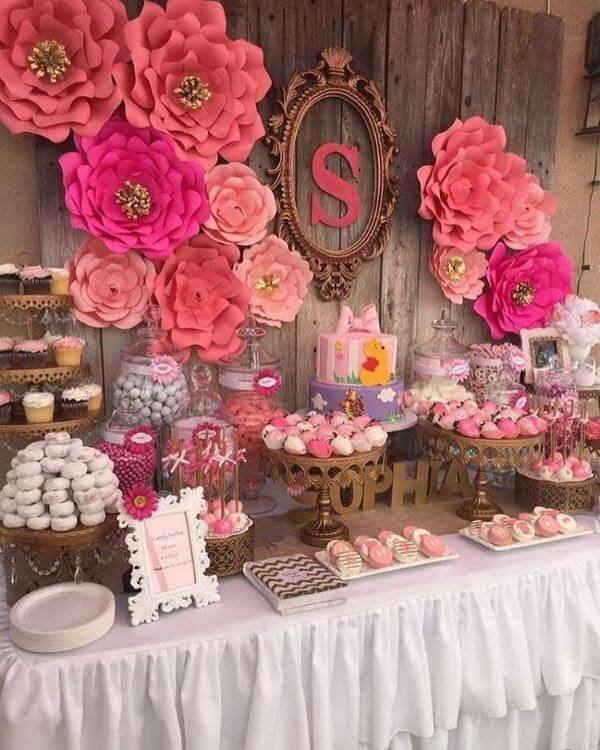 Party decoration with pink paper flowers