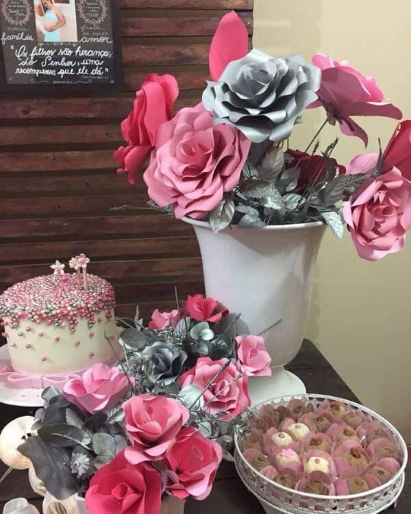 Paper flower arrangements in baby tea decoration