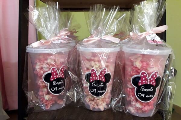 Customize cups and add popcorn