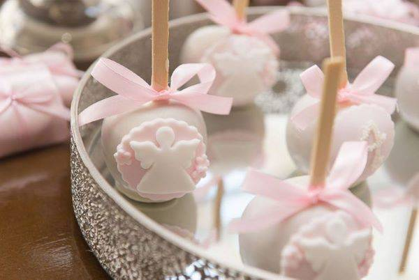 Personalized sweets as a souvenir of christening pink girl