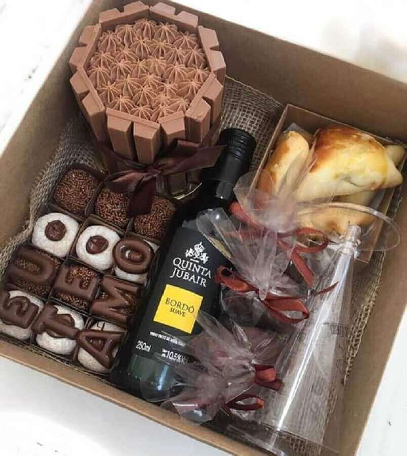 party model in simple box with chocolate and cake