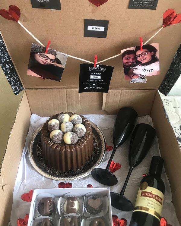 Party in the box with wine and chocolate cake