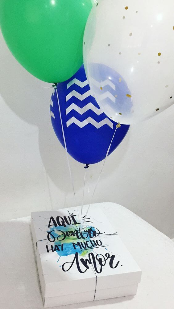 Party in the box with balloons