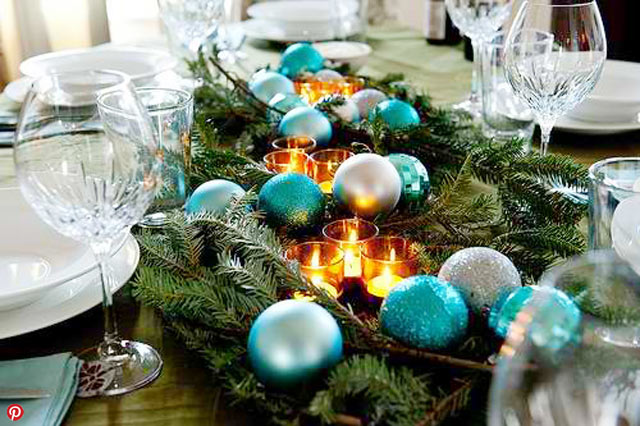 Christmas table decorations with blue decoration and candles