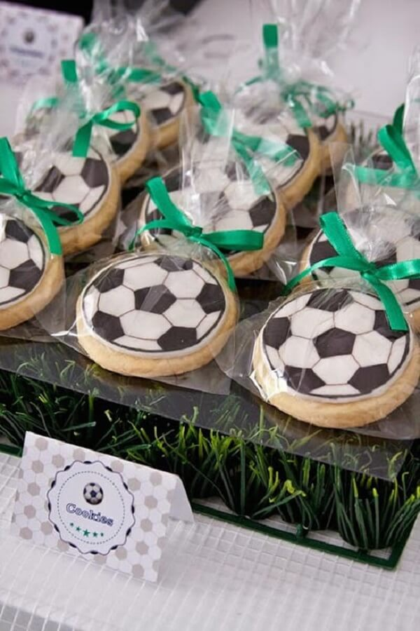 Ball shaped cookies used as a football theme children's party