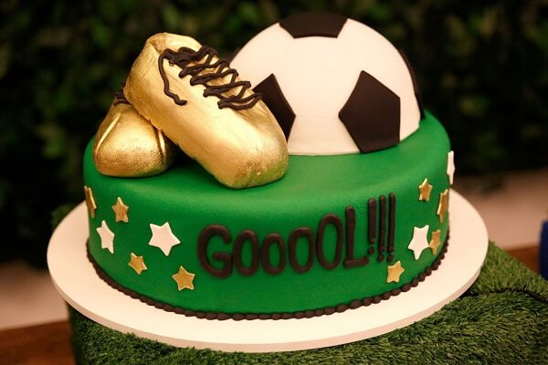 Creative cake made especially for party has soccer