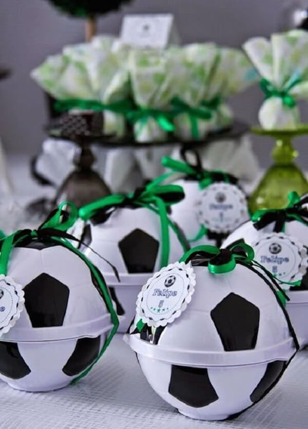 Fill the ball with chocolate, bullets, lollipops and chewing gum and use it in the football theme party souvenirs