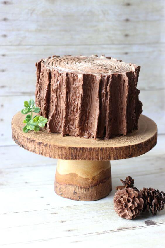 Enchanted garden cake imitating wood Photo by Bushka Cakery