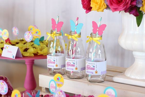 Personalized bottles in enchanted garden party Photo by Joy in the Box