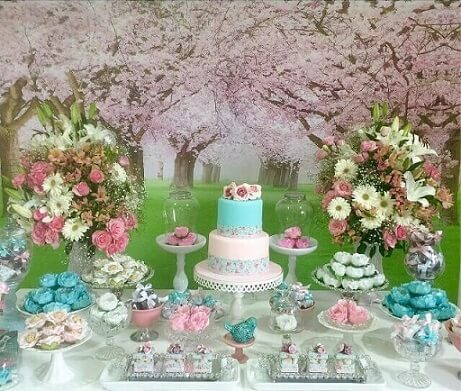 Enchanted garden party with flower print background Photo of Caramel Sweets and Decor