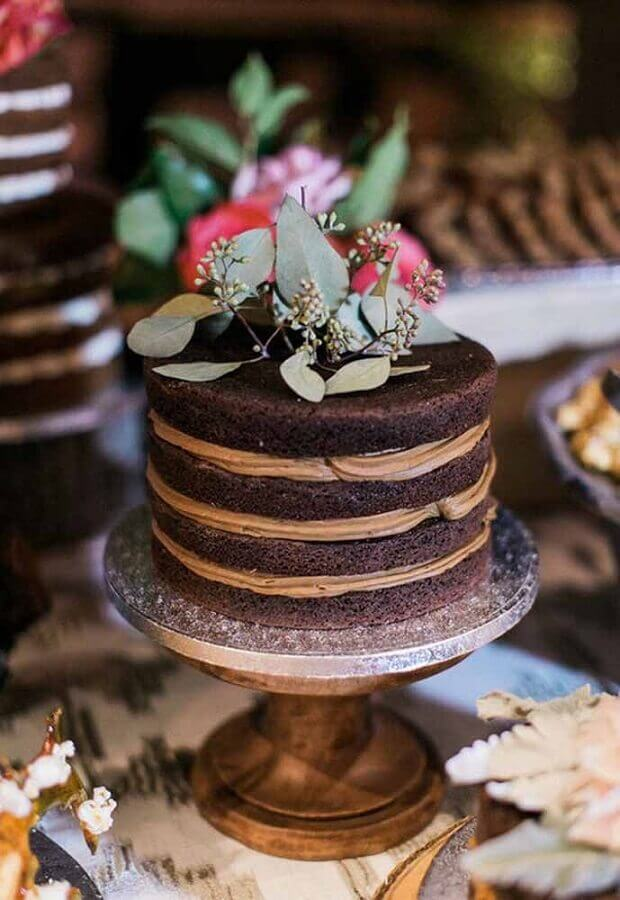 simple decorated chocolate cake with foliage on top Photo Dresses by Novia