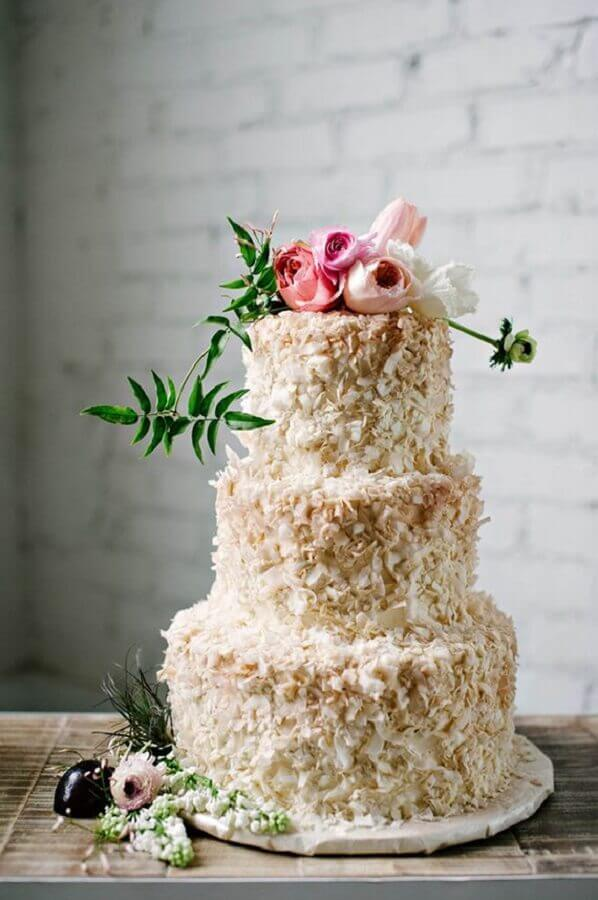cake decorated with flowers and coconut Photo WeddingOMania