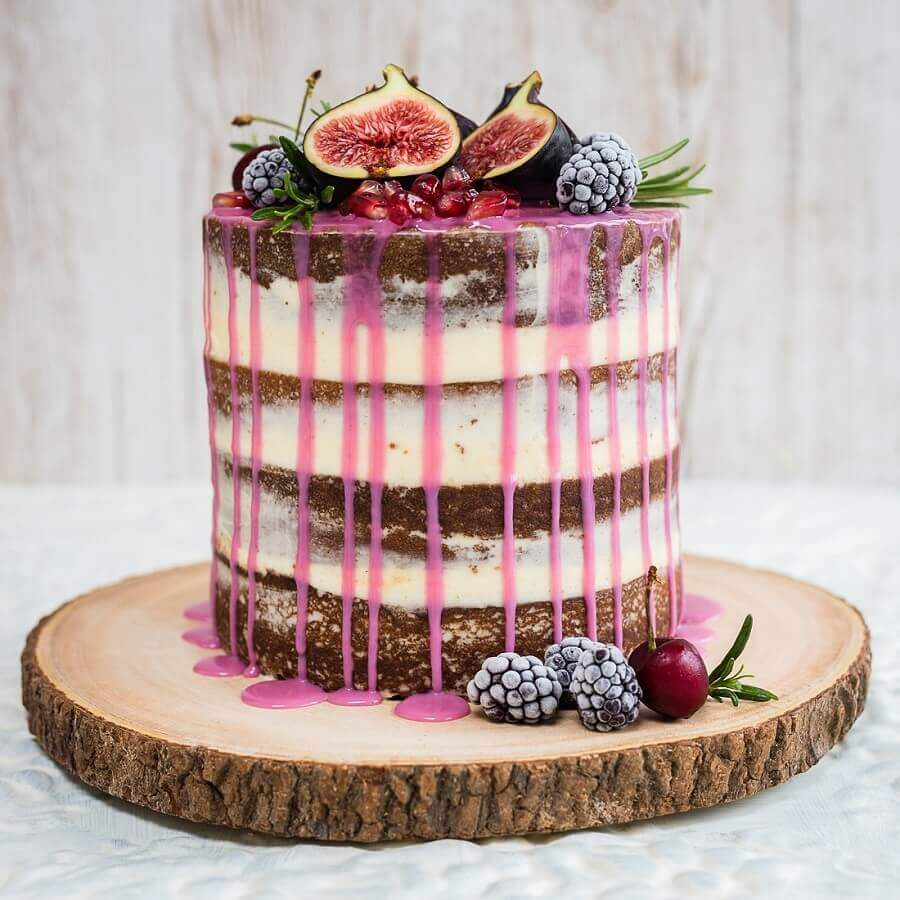 cake decorated with fruit and pink syrup Photo PS from Glass