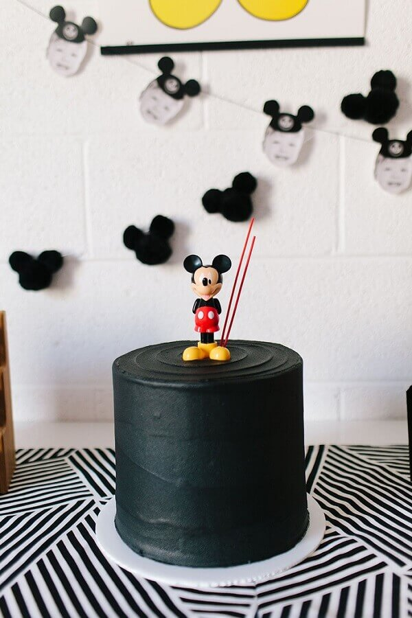 simple decorated cake all black with Mickey on top Photo Air Freshener